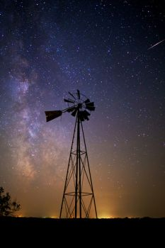 A lone windmill with the stars above west of Watertown.
