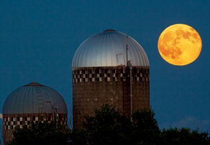 July's super moon with two farm silos southeast of Garretson.