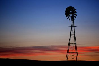 The sunset I was watching with a lone windmill silhouetted against the sky.