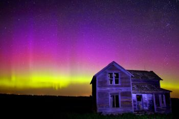 Northern lights above an abandoned farm house in McCook County.