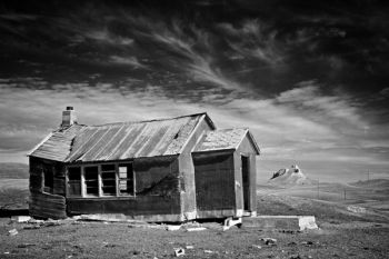 An abandoned schoolhouse with Castle Butte in the distance in Butte County.