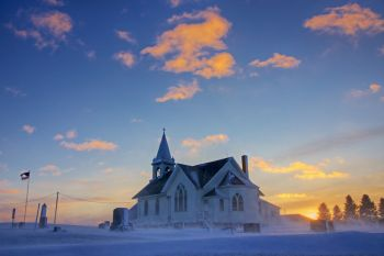 Winter's first blow at sunset at Benton Lutheran Church of rural Crooks.