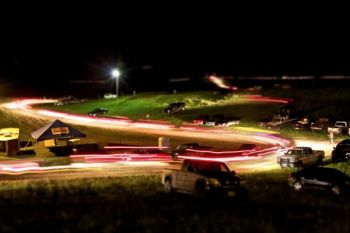 The scene after the rodeo as hundreds of cars descend from the Coteau Hills and into the night.