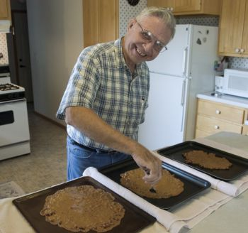 'Women cook 365 days a year; a guy does one thing and look who gets the credit,' quipped Marion Kryger, as he made peanut brittle.