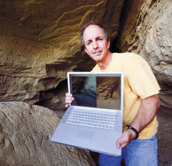 Paul Horsted used a laptop on the trail to compare William Illingworth's photos to his own.