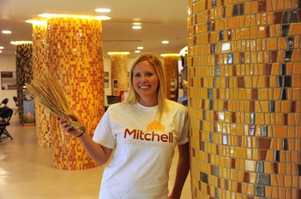 Katie Knutson shows the newly-decorated columns in the Corn Palace lobby.