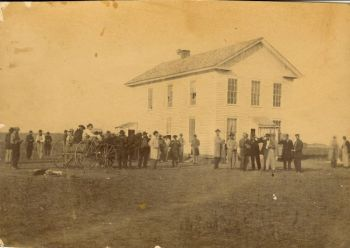 Pioneer politicians and members of the 'Yankton gang' gather at the first territorial capitol in downtown Yankton.
