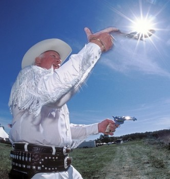 Sometimes you get really lucky like when this fancy gun spinner's pistol rotated right into the sunburst. Fill flash kept the cowboy from being completely silhouetted.