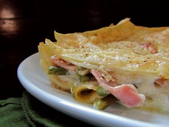 Ham and asparagus lasagna combines the flavors of a traditional Easter meal with hearty pasta and a creamy cheese sauce.