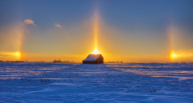 "Christian Begeman's sundogs photo ranks really high in my book,"" says Heidi Marsh, co-publisher.  I'd say it's one of my favorite photos for the entire year!"