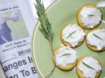 Creamy homemade goat cheese flavored with garlic, lemon and rosemary makes a tasty spread for crackers. Photo by Bernie Hunhoff.