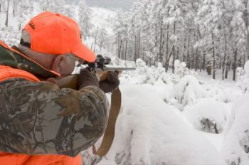 A hunter takes aim in the snowy Black Hills. S.D. Tourism photo.