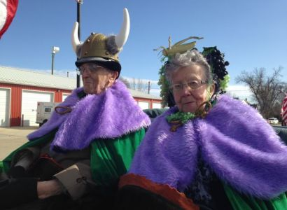 Grand Marshals Marvin Martilla and Lila Grape wear royal purple and Nile green, traditional colors of St. Urho s Day.