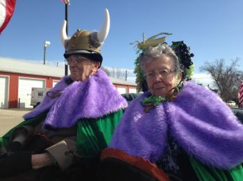Grand Marshals Marvin Martilla and Lila Grape wear royal purple and Nile green, traditional colors of St. Urho's Day.