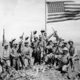 Mitchell native Jack Thurman is shown at the far left, waving his cap, in Joe Rosenthal s famous World War II photograph. Click to enlarge photo.