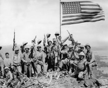 Mitchell native Jack Thurman is shown at the far left, waving his cap, in Joe Rosenthal's famous World War II photograph. Click to enlarge photo.