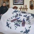 Janet Holland displays her birthday quilt. Photo by Donna Palmlund.