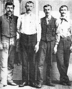 Hartington, Neb., photographer E.S. Kibbe shot this photo of Frank and Jesse James (third and fourth from right) with two Nebraskans, Adolph Gerdau and W.H. Harm.