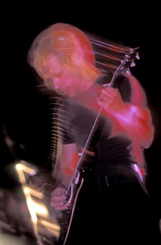 Blur isn't always a bad thing in photographs. Here's Chris Beyer again with his guitar strings leaving light trails.