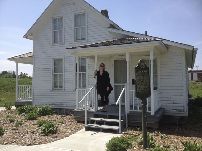 Katie Hunhoff, dropping off our 2015 geocache at the Berdahl-Rolvaag House at Augustana University.