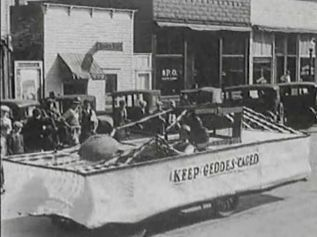 'Keep Geddes Caged' was the theme of this float, filmed by Lawrence Cool of Platte.