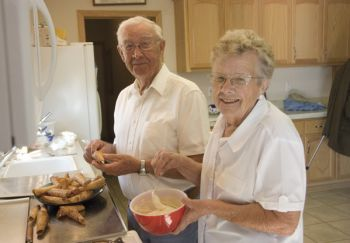 Swede and Ardys Olson, partners in a krumkake-making tradition.