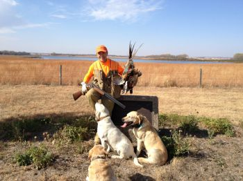Copper and crew celebrating a successful Terry Redlin hunt.