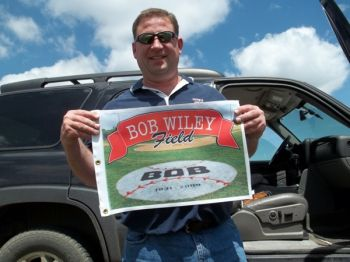 Chad Hesla shows off the Bob Wiley Classic tournament flag.