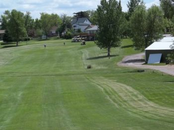 The #9 fairway – note the cart shed with ball-dented roof to the right.