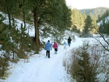 The Mickelson Trail, one of the sites participating in the First Day Hikes program, hosts several snowshoe hikes throughout the winter. Photo by South Dakota Game, Fish & Parks.