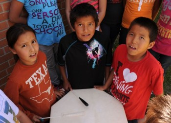 The survival of Lakota culture depends on the young. Last spring, students at North Elementary in Mission (Allen Antelope, Jeff Mandan and Loren White Hat) learned the Lakota flag song for their school's wacipi. Photo by Bernie Hunhoff.