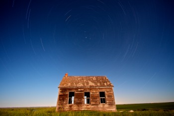 The moon was out at Lightcap, SD in June — it lit up the landscape like the sun after the long hour and 20 minute exposure. Lightcap was a town at one point earlier in the century, but now only the schoolhouse and one other building remain.
