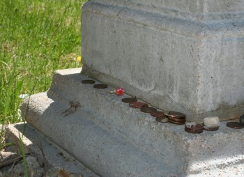 Many visitors leave coins and trinkets throughout the cemetery.