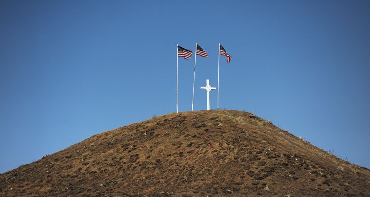Flags fly on a butte above the little reservation town of Rock Creek.