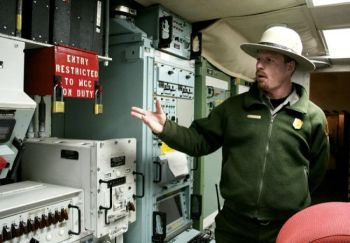 A National Park Service employee points to the double-locked red box that concealed the code and keys for a missile launch at the <a href='http://www.nps.gov/mimi/index.htm' target='_blank'>Minuteman Missile National Historic Site</a>. 2007 photo by Paul Higbee.