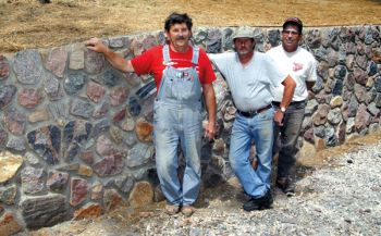 Don Miotke, Fred Miotke and Kenny Okroi have years of wall-building experience. Walls need a strong foundation, but the aboveground look is unique to each mason.