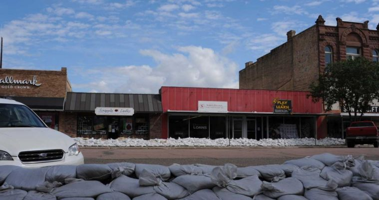Sandbags have lined both sides of Pierre s main street all summer long, but as it turned out the water boiled up from underneath, causing damage to the stores  basements.