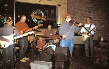 The Poker Alice Band in 2004: Nick Schwebach, Larry Rohrer, Al Remund, Owen DeJong and Dennis Johnson. Photo by Jerry Wilson.