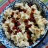 Pomegranate seeds provide antioxidants and a sweet counterbalance to a bowl of salty popcorn.