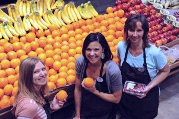 Pomegranate Market strives to attract like-minded farm suppliers, customers and staffers. In 2011, helpful staff members included (from left) Natalie McFarland, Kristen Perschon and Patty Ammann.