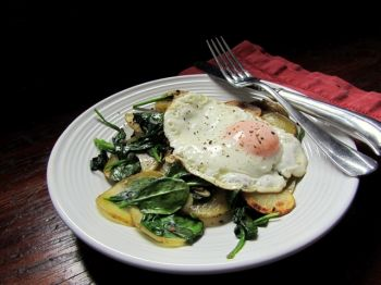 The runny yellow yolk of a fried egg perfectly compliments Fran Hill's earthy potato and spinach hash.
