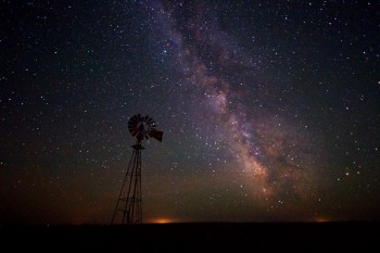 Taken just south and east of Isabel, SD in June. The lights of Eagle Butte, SD are on the horizon.