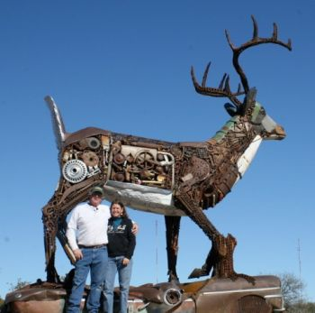 Brett and Tammy Prang beside Scrappy, their 17-foot metal deer. Tammy Prang photo.