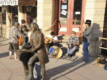 A group of street musicians, with Thomas Jefferson sitting in on quill. <a href='http://www.hlavka.com/' target='_blank'> Edward Hlavka</a> sculpted the Sage of Monticello for Rapid City's <a href='http://www.visitrapidcity.com/whattodo/thecityofpresidents/' target='_blank'> City of Presidents</a>, a series of life-size bronzes of the men who have held our country's highest office.