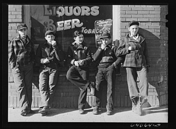 'Younger boys are standing in front of pool halls this year.' This photo, taken by John Vachon in 1942 in Roscoe, SD, is part of the Library of Congress prints and photographs collection.