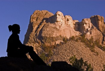 A summer sunrise gives a nice color to the mountain, but the shadows can hide Roosevelt's face.