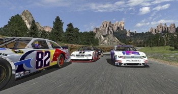 """Virtual"" NASCAR stock cars race by the Needles rock formations in Custer State Park in this video game version of the famous highway."