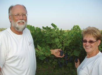 Jim and Nancy Schade at their Volga vineyard.