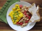 Dream of that new front porch over a breakfast of scrambled eggs with pesto and white beans.