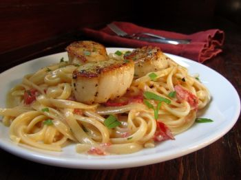 Sweet scallops over linguini could win your Valentine's heart.